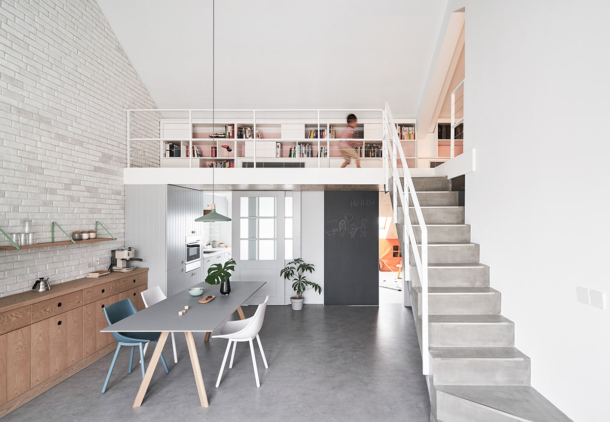 Thiết kế căn hộ phong cách hiện đại Small Library In Apartment Loft With White Shelving And Storage Over Small Eat In Kitchen